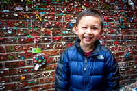 Avery thinks the gum wall is amusing, Seattle, WA