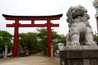 Red Torii gate and lion somewhere in Tokyo
