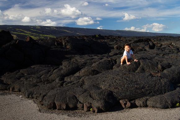 Avery enjoys climbing on the lava flow
