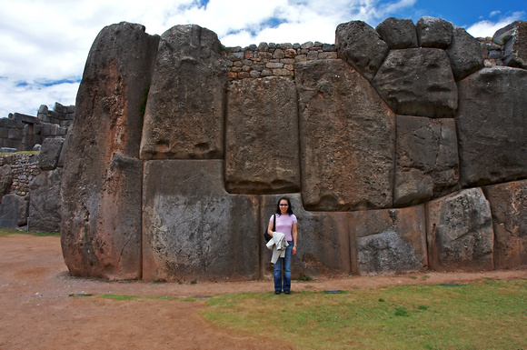 Natalie is dwarfed by the enormous stones used to build the Saqsaywaman walls