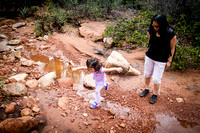 Adelyn hops a stream in Fay Canyon, Sedona, AZ